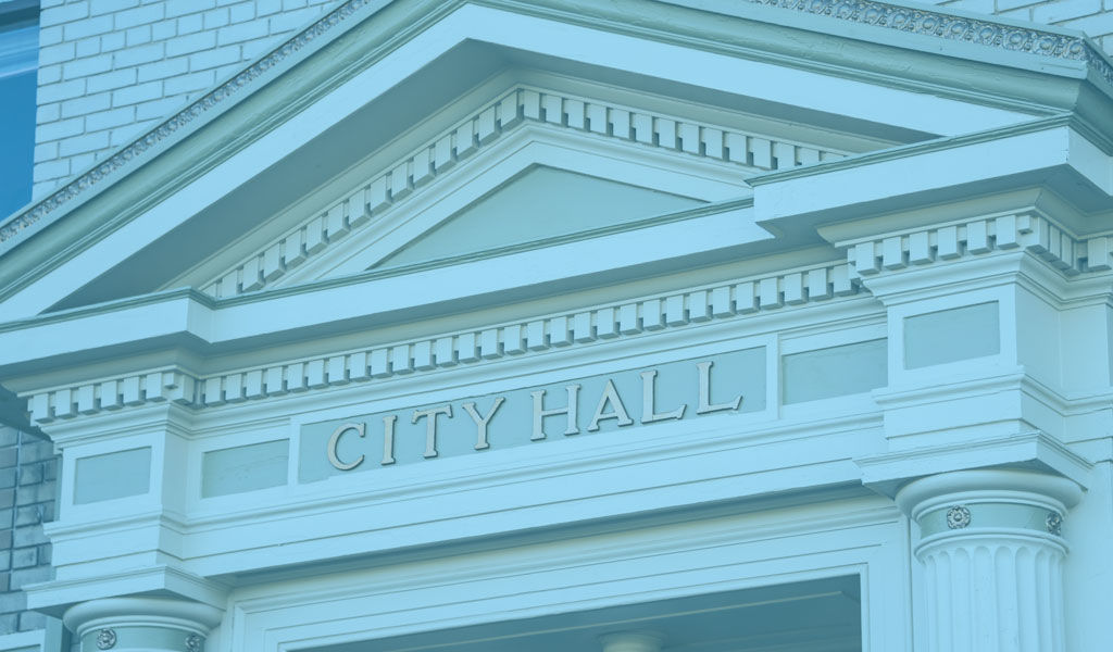 City hall building with a sign above entrance
