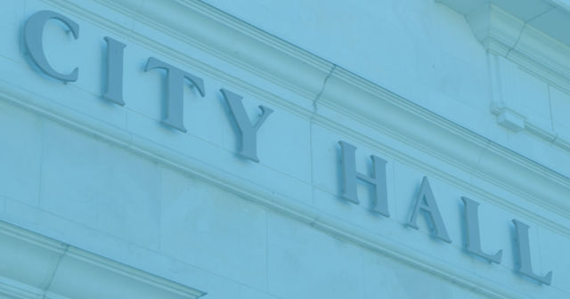 City Hall sign on the side of the building