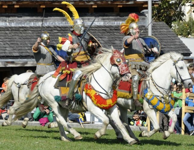 Medieval armored men on horses